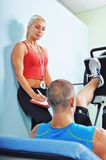 Athlete man in gym with personal fitness trainer Royalty Free Stock Photo