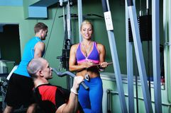 Athlete man in gym with personal fitness trainer. Two athlete men in gym with personal fitness trainer Stock Images