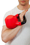 Athlete man holding the red kettlebell Stock Images