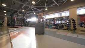 Athlete man jumping on platform on crossfit training in fitness club slow motion royalty free stock photos