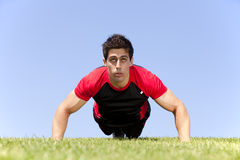 Athlete man making pushups Stock Images