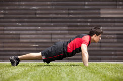 Athlete man making pushups Royalty Free Stock Image