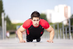 Athlete man making pushups Stock Image