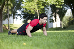 Athlete man making pushups Royalty Free Stock Photos