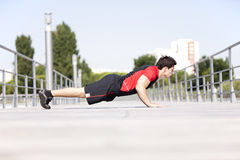 Athlete man making pushups Stock Photos