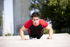 Athlete man making pushups Royalty Free Stock Photo