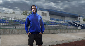 Athlete man posing over grunge stadium. Wide HDR Royalty Free Stock Photos