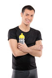 Athlete man posing with a plastic bottle Royalty Free Stock Image