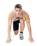 Athlete man ready to run. Full length portrait of athlete man ready to run, looking at camera isolated on white background Royalty Free Stock Images