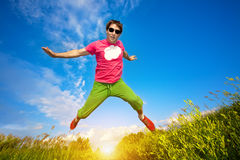 Athlete man runing against the blue sky Royalty Free Stock Photo