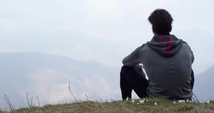 Athlete man runner resting sitted.Real people adult trail running sport training in autumn or winter in wild mountain. Outdoors nature, bad foggy weather.4k stock video footage