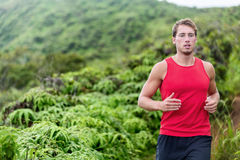 Athlete man runner trail running in nature Royalty Free Stock Images