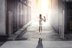 Athlete man running race. Mixed media royalty free stock images
