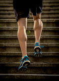 Athlete man with strong leg muscles training and running urban city staircase in sport fitness and healthy lifestyle concept Royalty Free Stock Photos