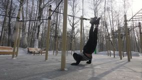 Man training with sport straps on outdoor winter ground. Sport and healthy. Athlete man training with sport straps on outdoor winter ground. Man using fitness stock video footage