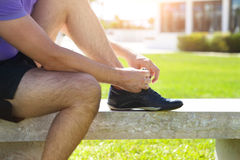 Athlete man trying running shoes getting ready for jogging Stock Image