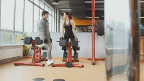 Athlete man and woman have conversation in the gym. Athlete men and women have conversation in the gym - horizontal Royalty Free Stock Image