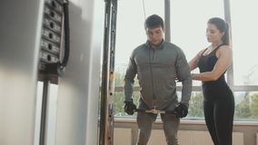 Athlete man performs exercises in the gym. Athlete men performs exercises in the gym, close up Stock Photos