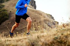 Athlete men runner. Mountain marathon running uphill athlete men runner royalty free stock images