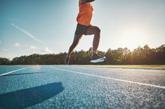 Athlete in mid air while sprinting down a running track royalty free stock photos
