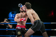 Athlete mixed martial arts gets strong jab hand to his opponent Stock Images