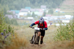 Athlete mountainbikers climb mountain. On foot with bicycle during competitions in cross-country Royalty Free Stock Image