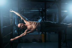 Athlete with muscular body training on bar Stock Image