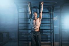 Athlete with muscular body training on bar Stock Photo