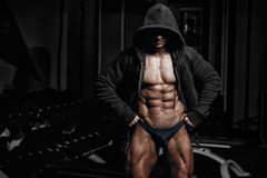 Athlete muscular bodybuilder man demonstrates his muscles in the gym Royalty Free Stock Image
