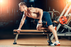 Athlete muscular bodybuilder training back with Royalty Free Stock Images