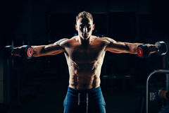 Athlete muscular bodybuilder training back with Stock Photography