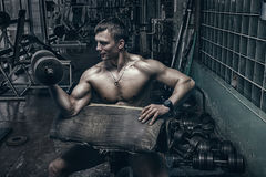 Athlete in old rusty gym Royalty Free Stock Photos