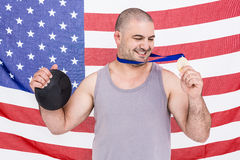 Athlete with olympic gold medal Royalty Free Stock Image