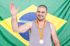 Athlete with olympic gold medal Stock Photo