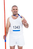 Athlete with olympic gold medal holding javelin Stock Images