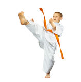 An athlete with an orange belt beats mae-geri. Athlete with an orange belt beats mae-geri royalty free stock photography