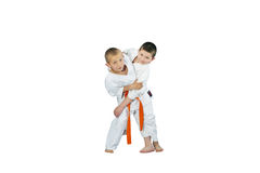 An athlete with an orange belt makes a grab for the throw Royalty Free Stock Photography