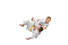 An athlete with orange belt throws athlete  with yellow belt Stock Image