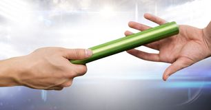 Athlete passing baton against digitally generated background. Digital composition of athlete passing baton against digitally generated background stock images