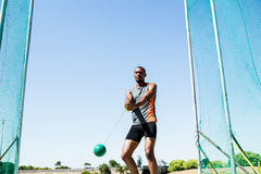 Athlete performing a hammer throw. Determined athlete performing a hammer throw in stadium royalty free stock photography