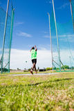 Athlete performing a hammer throw. In stadium royalty free stock photos