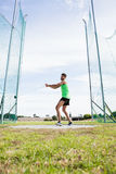 Athlete performing a hammer throw. In stadium stock image
