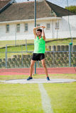 Athlete performing a hammer throw. In stadium royalty free stock photo