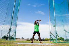 Athlete performing a hammer throw. In stadium stock photo