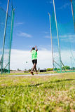 Athlete performing a hammer throw. In stadium royalty free stock photography