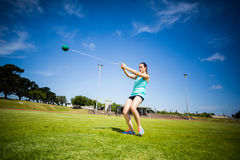 Athlete performing a hammer throw. In stadium stock photos