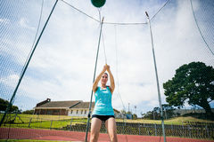 Athlete performing a hammer throw. In stadium stock images