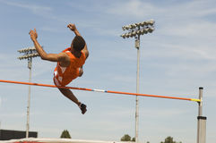 Athlete Performing High Jump Stock Photography