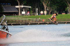 Athlete performing stunt during Rip Curl Singapore National Inter Varsity. SINGAPORE - JULY 20: Athlete performing stunt during Rip Curl Singapore National Inter Royalty Free Stock Photo