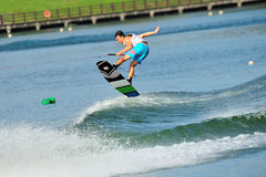 Athlete performing stunt during Rip Curl Singapore National Inter Varsity & Polytechnic Wakeboard Championship 2014 Stock Image